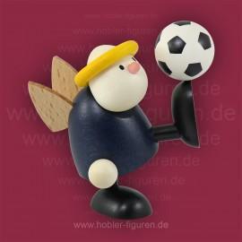 Hans mit Fußball balancierend